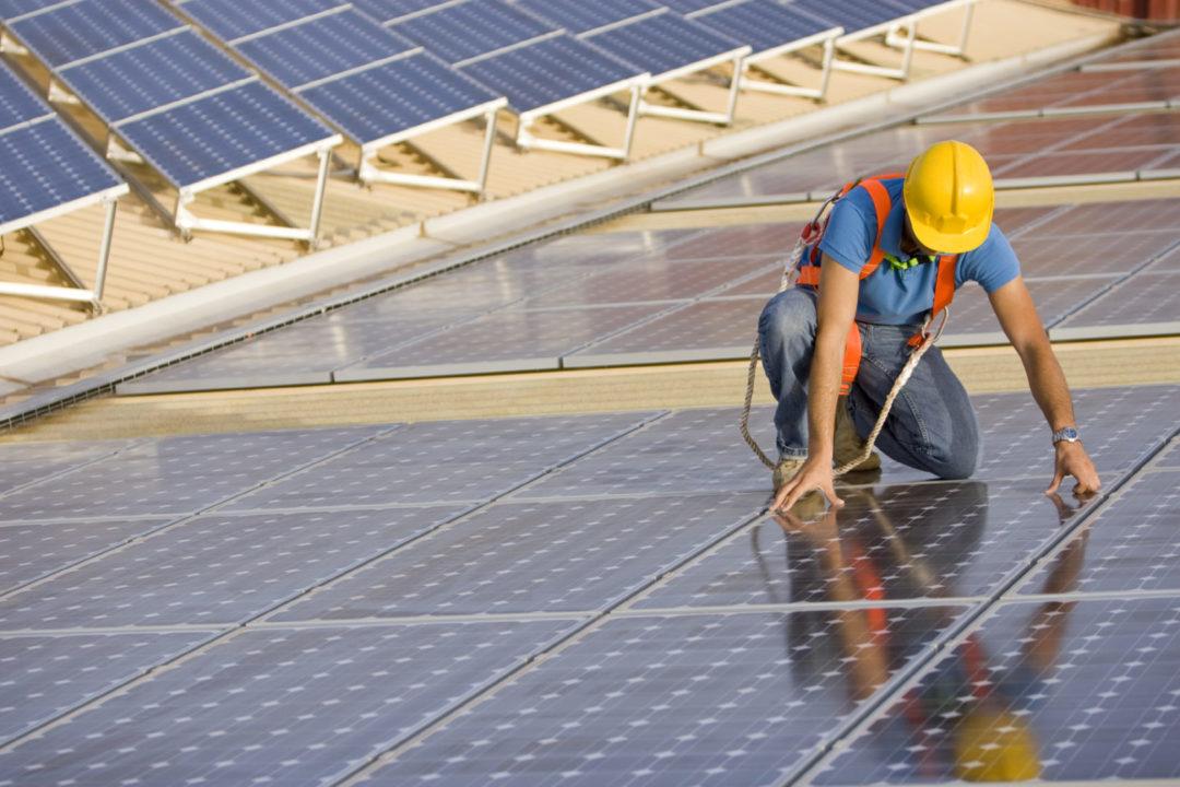 Advanced Energy Worker Placing Solar Panels